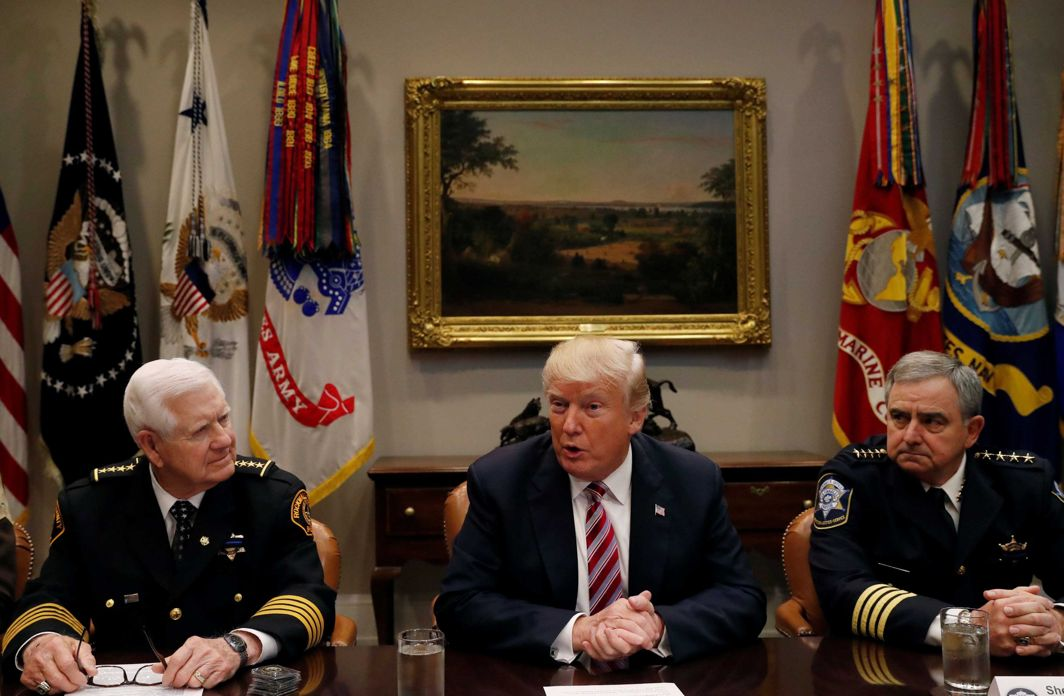 TOUGH TALK: US President Donald Trump talks to members of the National Sheriffs' Association including the association president Sheriff Harold Eavenson (L) and Sheriff Greg Champagne (R) during a roundtable at the White House in Washington, US, Reuters/UNI