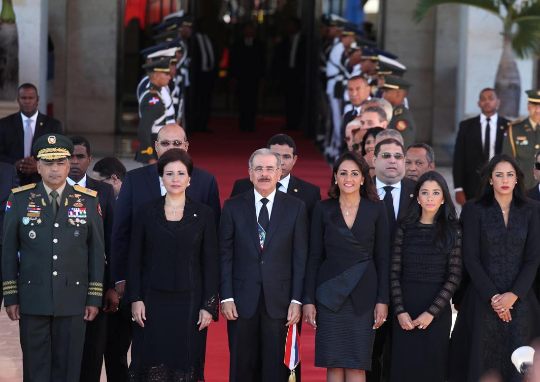 PROUD AND HANDSOME: Dominican President Danilo Medina (C), Vice-President Margarita Cedeno (L) and First Lady Candida Montilla (R) receive military honours during the Independence Day ceremony in Santo Domingo, Dominican Republic, Reuters/UNI