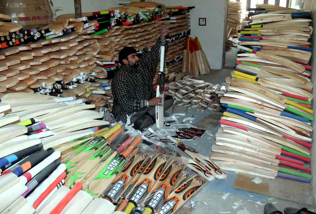 CRICKET FREAK'S PARADISE: A craftsman gives final touches to cricket bats made by Kashmir willow wood before those being transported to places all over the country, at a workshop in south Kashmir, UNI