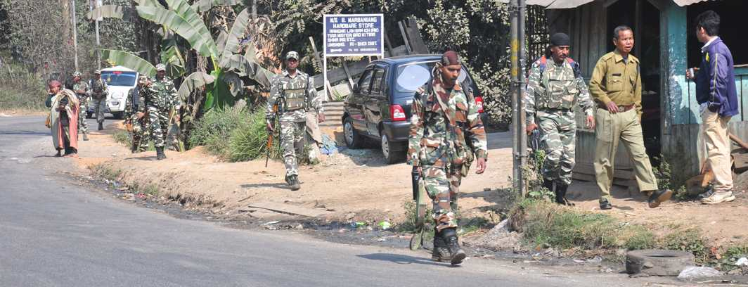 ON GUARD: Personnel of the paramilitary forces patrolling at Umsning locality in Ri-Bhoi district of Meghalaya ahead of the assembly election, at Umsning, UNI