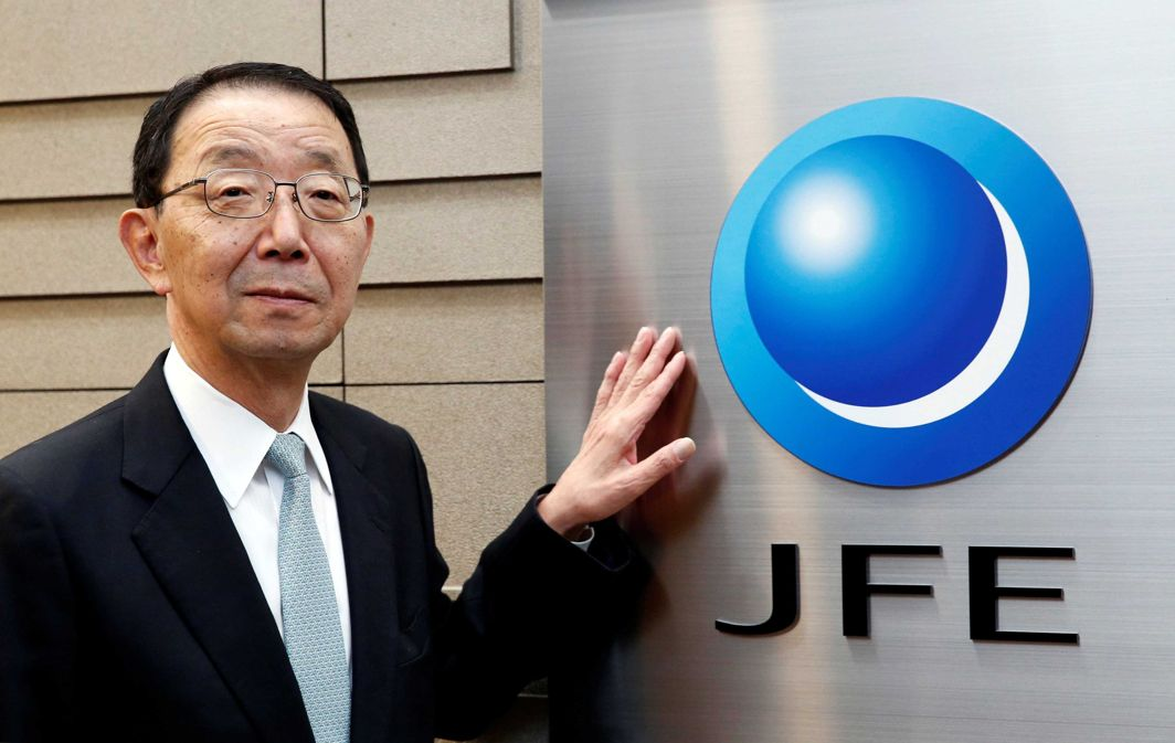 WHERE'S THE AUDIENCE? Eiji Hayashida, CEO and president of JFE Holdings Inc., poses for pictures next to the company logo at the company's headquarters in Tokyo, Japan, Reuters/UNI