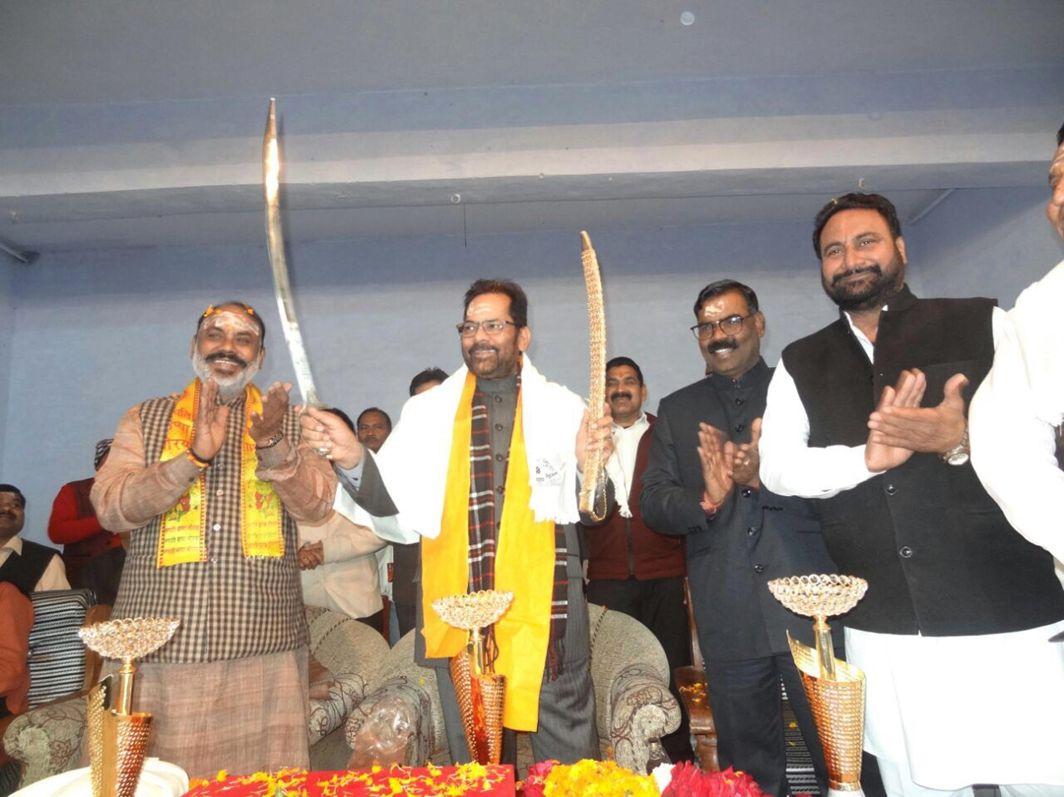 PAYING HIS DUES: Union Minister for Minority Affairs Mukhtar Abbas Naqvi inaugurates the Kisan Mela organised on the occasion of the auspicious Mahashivratri, at Rathonda, Milak in Rampur, Uttar Pradesh, UNI