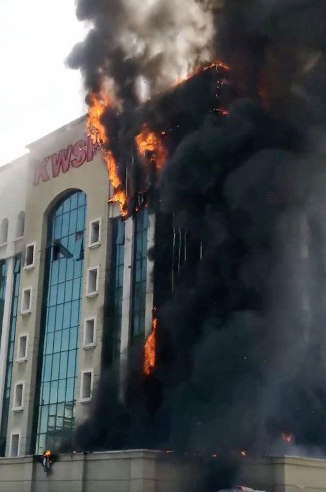 UP IN SMOKE: The pension fund building is seen on fire in Petaling Jaya, Malaysia, Reuters/UNI