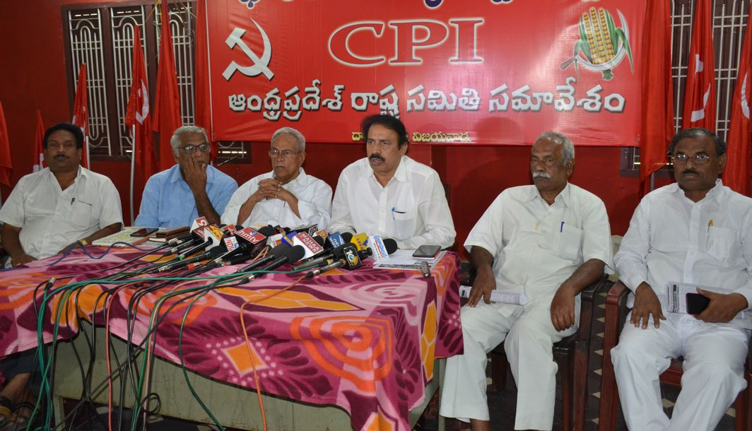 SETTING THE AGENDA: Andhra Pradesh CPI secretary K Ramakrishna, CPM secretary P Madhu and other Leftist leaders participate in a meeting on the ongoing agitation on special state status, railway zone and other issues of the AP Reorganisation Act, in Vijayawada, UNI