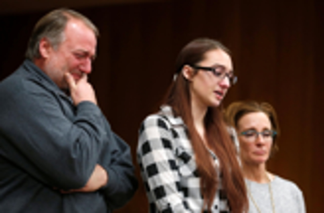 SURVIVOR: Megan Halicek gives her victim impact statement as her dad and coach stand with her during the sentencing hearing of Larry Nassar, a former team USA Gymnastics doctor who pleaded guilty in November 2017 to sexual assault charges, in the Eaton County Court in Charlotte, Michigan, US, Reuters/UNI