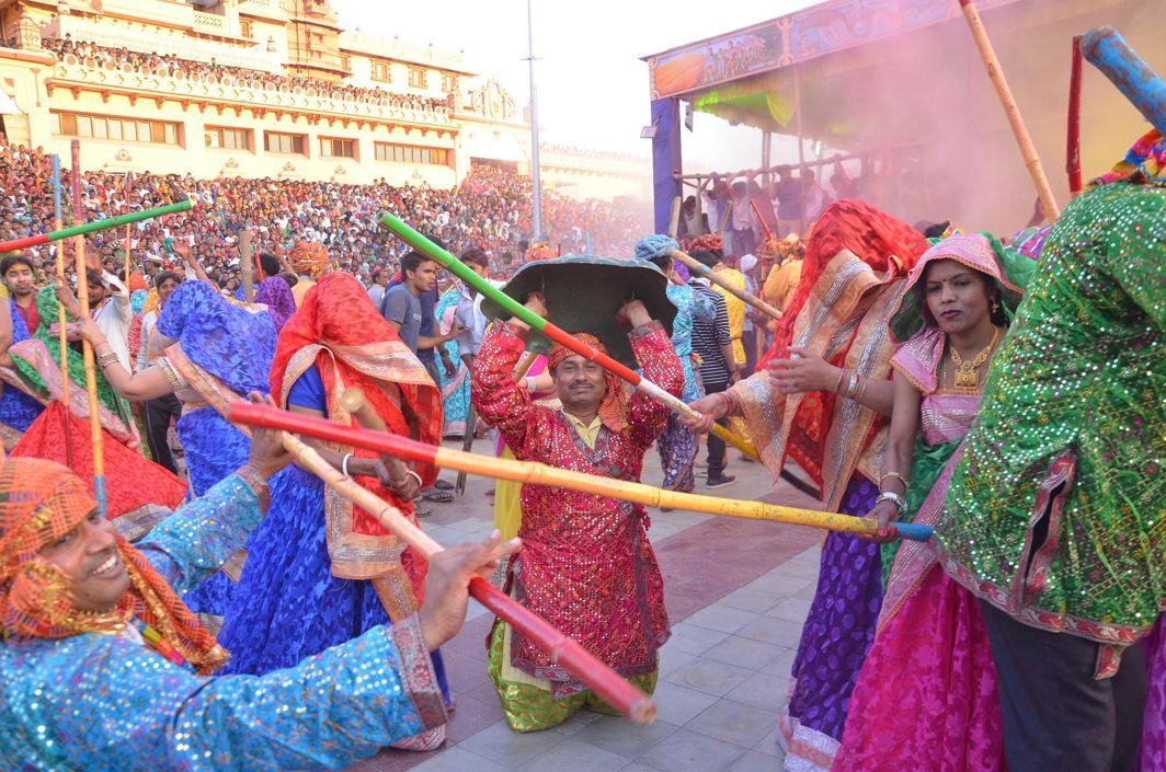 EARLY FESTIVITIES: Devotees celebrate Lathmaar Holi at Sri Krishna Janma Bhoomi Temple in Mathura, UNI