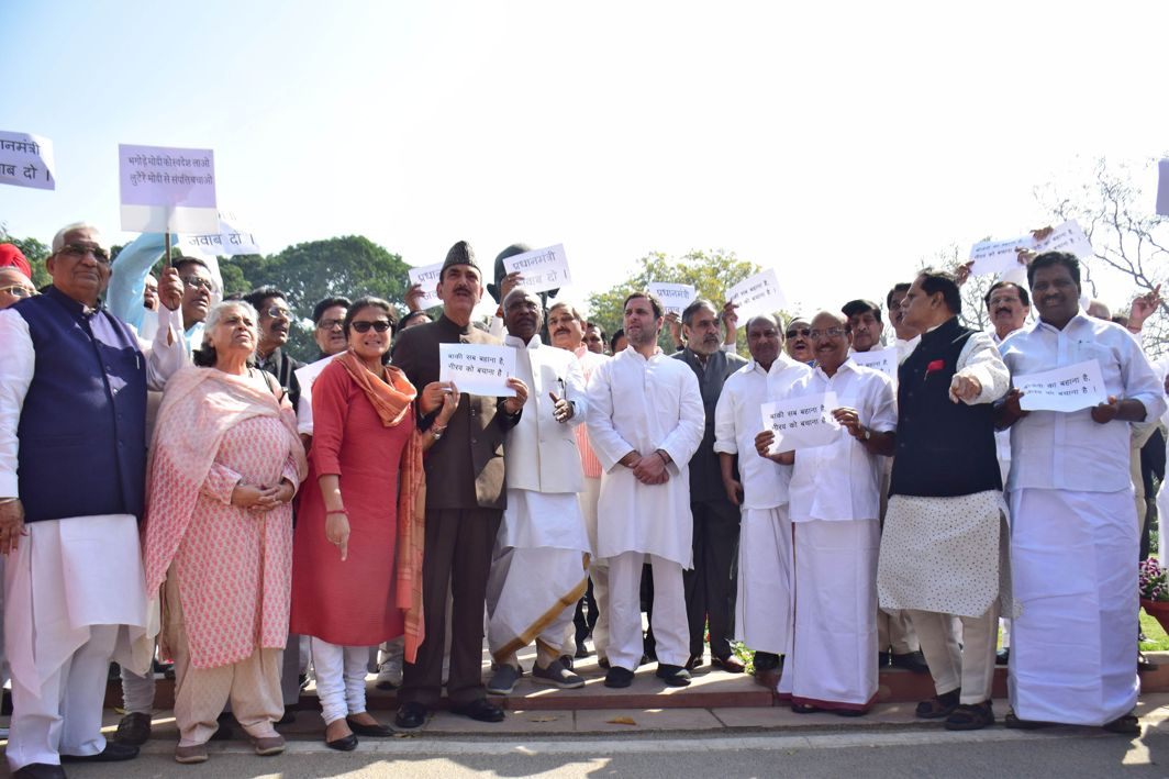 TO NO AVAIL: Congress MPs stage a demonstration in front of the Gandhi statue in protest against the Nirav Modi fraud, in New Delhi, UNI