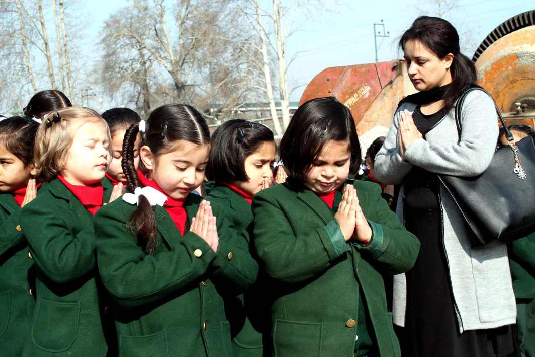 OUR FATHER IN HEAVEN: Students attend morning prayers on the first day of school after they reopen following winter vacation in Kashmir valley, UNI
