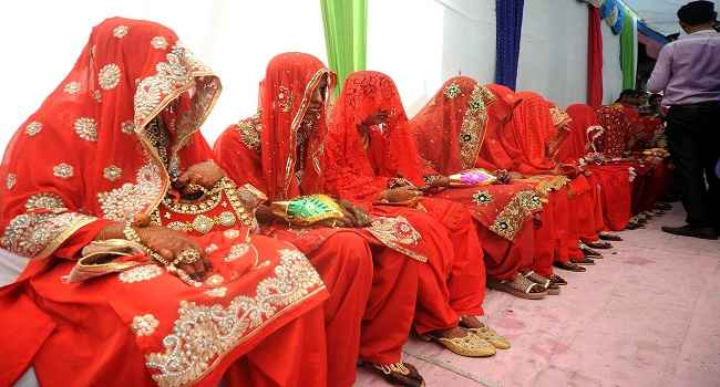 JOURNEY BEGINS: Muslim brides wait for their grooms at a mass marriage ceremony in Ahmedabad