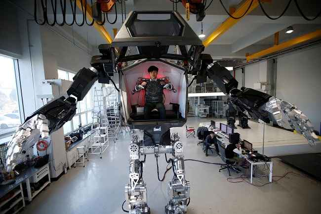 "GUNPO, DEC 27 :- An employee controls the arms of a manned biped walking robot ""METHOD-2"" during a demonstration in Gunpo, South Korea, December 27, 2016. REUTERS-12R"