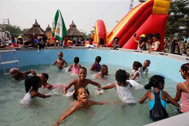 LAGOS, DEC 27 :- Children play in a pool at an amusement park during Boxing Day in Ikeja district, in Nigeria's commercial capital Lagos, December 26, 2016. REUTERS-1R