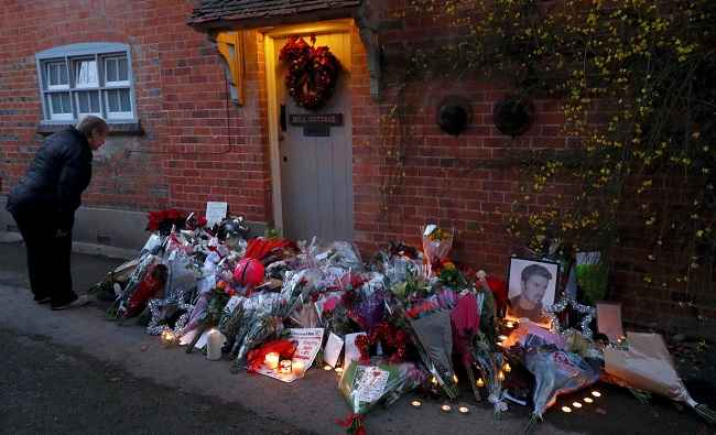 GORING, DEC 27 :- A woman looks at tributes outside the house of singer George Michael, where he died on Christmas Day, in Goring, southern England, Britain December 26, 2016. REUTERS-3R