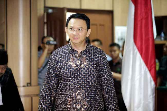 JAKARTA, DEC 27:- Jakarta's Governor Basuki Tjahaja Purnama walks inside the courtroom during his blasphemy trial at the North Jakarta District Court in Jakarta, Indonesia, December 27, 2016. REUTERS-5R