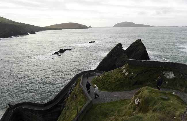 DRUMQUIN, DEC 28:- People look out at the Blasket and Skellig Islands from Drumquin pier in Drumquin, Ireland December 27, 2016. REUTERS-10R