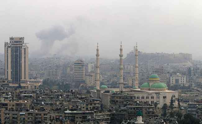 ONCE MAGNIFICIENT: Smoke rises after an airstrike in Aleppo; courtesy Reuters