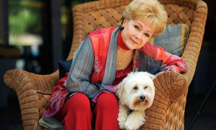 Debbie Reynolds with her dog Dwight in Beverly Hills, California, in May 2013, courtesy Chris Pizzello/Invision/AP