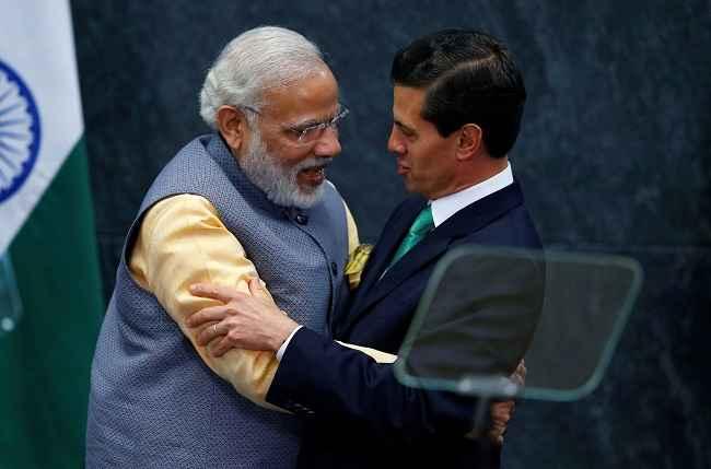 Modi embraces Mexican president Enrique Pena Nieto at Los Pinos
