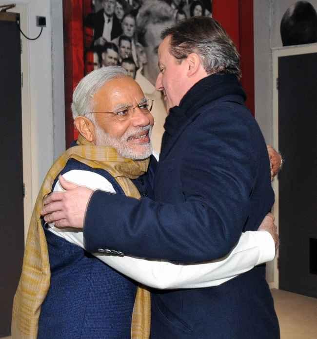 Modi greets British Prime Minister David Cameron